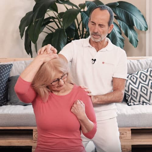 A woman is performing a neck pain exercise.