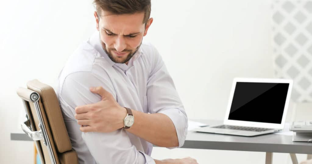 man with shoulder pain