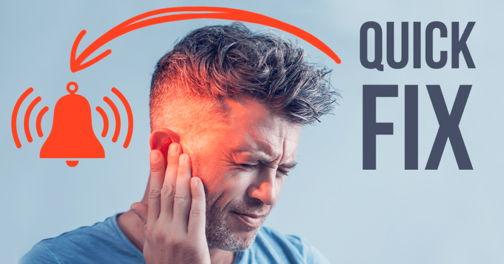 a man is covering his ear as he suffers from tinnitus